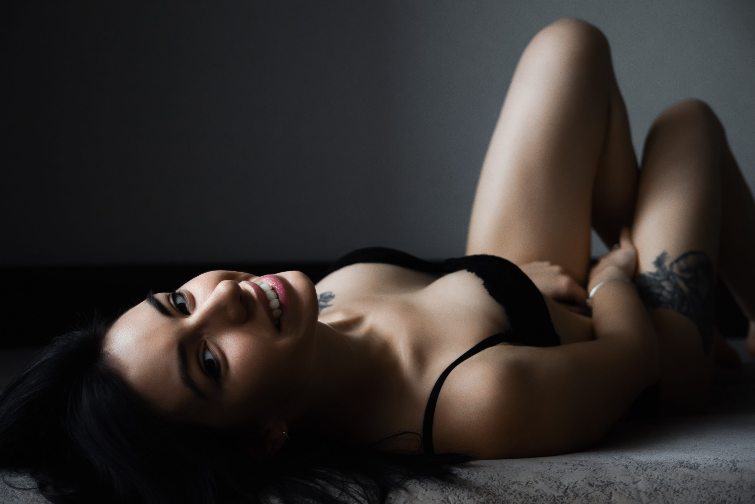 sexy girl lying in bed